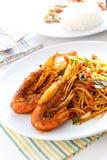 Italian Thai Fusion food spaghetti stir fry with Thai spicy an. Italian Thai Fusion food, Pasta spaghetti stir fry with Thai spicy and sour sauce (Tom Yum Kung royalty free stock photos