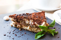 Italian tiramisu cake served on a plate Royalty Free Stock Images