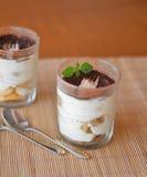 Italian tiramisu dessert on the brown plate Royalty Free Stock Photos