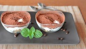 Italian tiramisu dessert on the brown plate Royalty Free Stock Image