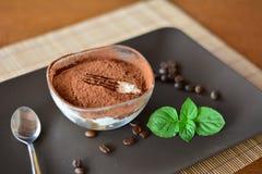 Italian tiramisu dessert on the brown plate Stock Photography