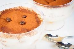 Italian tiramisu dessert served in a cup near spoons Royalty Free Stock Image
