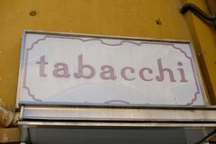 Italian tobacco shop. Signage of Tabacchi, Italian for Tobacconist. Also called a tobacco shop, a tobacconist`s shop or a smoke shop, it is a retailer of tobacco Royalty Free Stock Photo