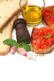 Italian tomato bruschetta. Basic ingredients for simple italian tomato bruschetta over white Stock Photography