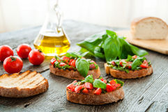 Italian tomato bruschetta with chopped vegetables Royalty Free Stock Image