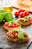 Italian tomato bruschetta with chopped vegetables Royalty Free Stock Images