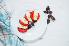 Italian tomato and mozzarella Caprese salad seasoned with pepper Royalty Free Stock Images