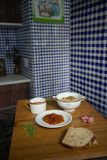 Italian tomato soup Brown rice risotto Papaya dessert served in Chinese porcelain dishes and bread stock photo