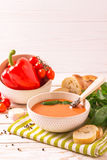 Italian tomato soup gazpacho with basil, tomatoes and baguette Stock Photo