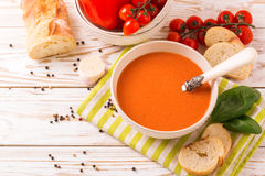 Italian tomato soup gazpacho with basil, tomatoes and baguette Royalty Free Stock Image