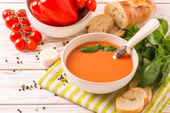 Italian tomato soup gazpacho with basil, tomatoes and baguette Stock Photos
