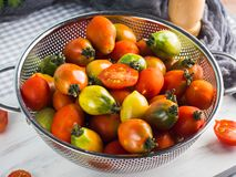 Italian tomatoes in a colander on table Royalty Free Stock Image
