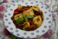 Italian tortellini with beans. Some italian tortellini with red beans and paprika Stock Images