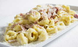 Italian tortellini. Delicous italian tortellini with ham and parmesan royalty free stock photos