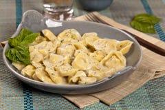 Italian tortellini pasta with cheese sauce