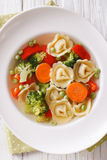 Italian tortellini soup with broccoli, peas, carrot and pepper c Royalty Free Stock Photo