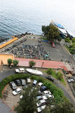All kind of vehicles in Sorrento, Italy. In the Italian town of Sorrento along the Tyrrhenian Sea scooters are parked in a row and cars in a circle. A Paul & stock photography