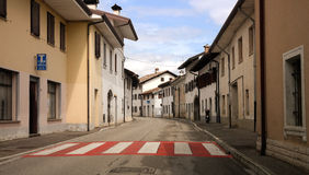 Italian town. Italian street of a provincial town and red pedestrian crossing Royalty Free Stock Images