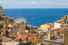 Town of Riomaggiore in the Cinque Terre, Italy. Overlooking the rooftops and out to the sea. stock image