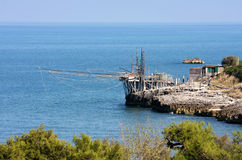 Italian trabucco near Vieste in the Adriatic Sea. A hundred-year-old Trabucco-old timber structure, used to cast fishing nets into the sea, near Vieste, a small stock image