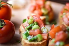 Italian traditional bruschetta close up baguette. Macro Stock Image