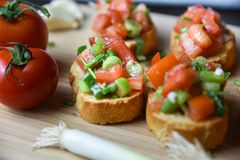 Italian traditional bruschetta close up baguette. Macro Stock Photos