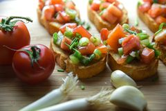 Italian traditional bruschetta close up baguette. Macro Stock Images