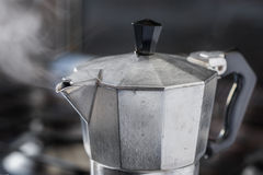 Italian traditional coffeemaker moka. Italian traditional coffeemaker with hot steam blowing out from the spout Stock Images