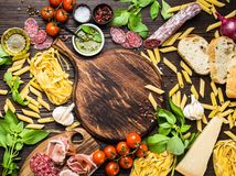 Italian traditional food, appetizers and snacks. Top view of Italian traditional food, appetizers and snacks as salami, prosciutto, cheese, pesto, ciabatta Royalty Free Stock Photography