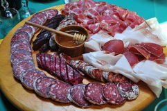 Italian traditional mountain salami and ham. Stock Images