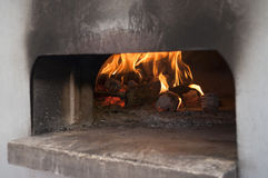 Italian traditional pizza  wood oven. On fire Royalty Free Stock Photography