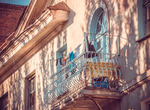 Italian traditions. Old balcony and clothesline. Balcony of the old houses in the Italian style. The charm and simplicity of domestic life Royalty Free Stock Images
