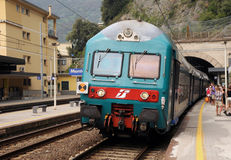 Italian train. A local train stops at Monterosso, one of the stunningly beautiful  Italian Cinque Terre villages and a UNESCO world heritage site Stock Photos
