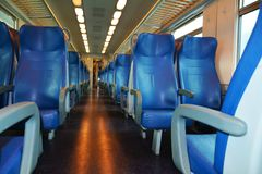 Italian train. Chairs, lights and windows, in Treviso train station, Veneto, Europe Royalty Free Stock Photos