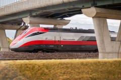 Italian train Frecciarossa running. Novara, Italy -June 25, 2017: High speed train ride in motion. Italian Frecciarossa running to Milan. Editorial Photo Royalty Free Stock Photo