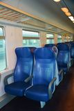 Italian train, inside. Empty and blue chairs in a speedy Italian train, in Venice, Italy, Europe Royalty Free Stock Image