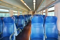 Italian train, Venice. Blue chairs, beautiful windows, in a speedy Italian train, in Venice, Italy, Europe. Lights on, in the evening Stock Photo