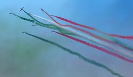 Planes jet of Italian tricolor arrows in acrobatic team during air show, in a spectacular acrobatics. Italian tricolor arrows in a spectacular flight, during air Stock Photo