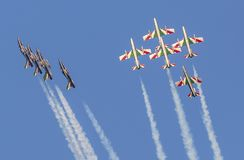Planes jet of Italian tricolor arrows in acrobatic team during air show. Italian tricolor arrows in a spectacular acrobatic figure during air show.: the bomb Stock Image