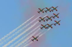 Planes jet of Italian tricolor arrows in acrobatic team during air show. Italian tricolor arrows in a spectacular flight, during air show Stock Photography
