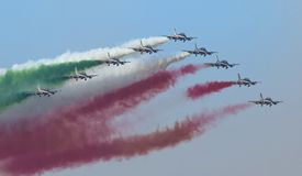Planes jet of Italian tricolor arrows in acrobatic team during air show. Italian tricolor arrows in a spectacular flight, during air show Stock Image