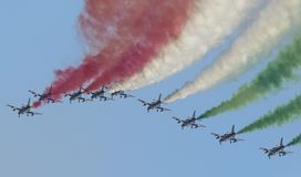 Planes jet of Italian tricolor arrows in acrobatic team during air show. Italian tricolor arrows in a spectacular flight, during air show Stock Photo