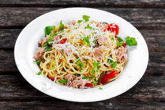 Italian Tuna Pasta spaghetti with tomato, chilli, parmesan and wild rocket  lives. on old wooden table Royalty Free Stock Photo