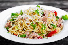 Italian Tuna Pasta  spaghetti with tomato, chilli, parmesan and wild rocket  lives. on old wooden table Royalty Free Stock Image