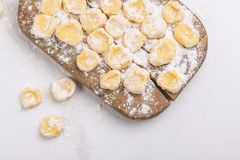 Italian uncooked homemade potato gnocchi with flour. royalty free stock photography