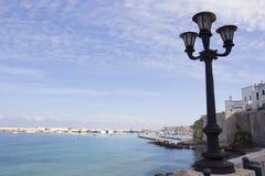Italian vacation - Otranto in Salento. Otranto: lamppost and harbor views Stock Photo