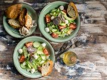 Italian vegetable salad with avocado, cherry tomatoes, arugula and mozzarella cheese. Delicious and healthy food. Mediterranean. Delicious and healthy food royalty free stock photo