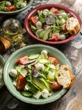 Italian vegetable salad with avocado, cherry tomatoes, arugula and mozzarella cheese. Delicious and healthy food. Mediterranean. Delicious and healthy food stock images