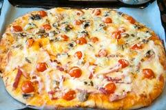 Italian vegetarian pizza on the baking tray. Stock Photos