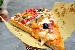 Italian vegetarian pizza on the streets of Italy Stock Photography